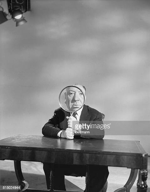 Alfred Hitchcock plays with a magnifying glass on the set of his television show Alfred Hitchcock Presents which aired from 19551965