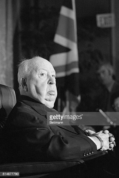 Alfred Hitchcock sits at a press conference in which British Consul General to Los Angeles Thomas Aston announced formally that Hitchcock has been...