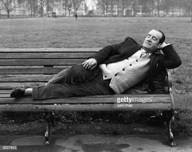 Alfred Lennon father of John Lennon of The Beatles relaxing on a park bench 18th December 1965
