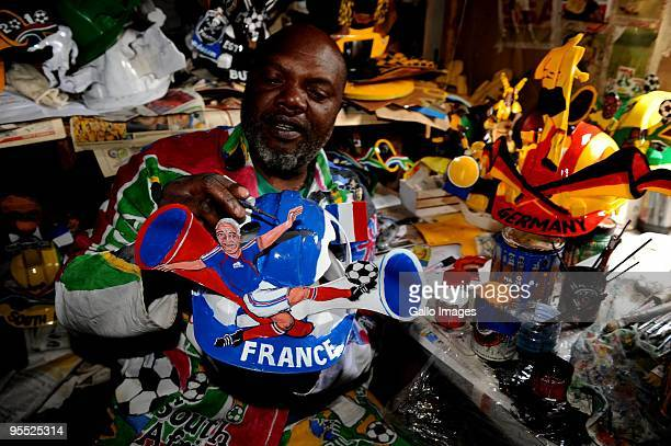 Alfred 'Lux' Baloyi designs a famous Makarapa football 2010 helmet on January 1 2010 in Germiston South Africa Baloyi also known as 'The Magistrate'...