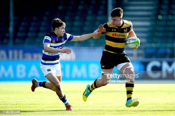 Alfred Mawdsley of Wasps u18's is tackled by Nat Arnold of Bath u18's during the 3/4th Place Playoff match between Bath U18's and Wasps U18's during...