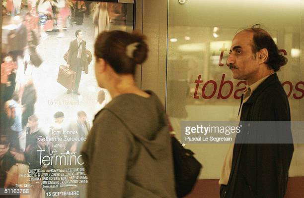 Alfred Merhan stands next to the Steven Spielberg's movie poster in his home of 16 years a corner of Terminal 1 at Paris' Charles de Gaulle airport...