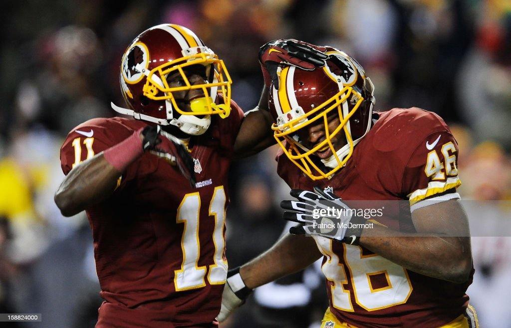 Alfred Morris #46 celebrates his fourth quarter touchdown with Aldrick Robinson #11 of the Washington Redskins during their game against the Dallas Cowboys at FedExField on December 30, 2012 in Landover, Maryland.