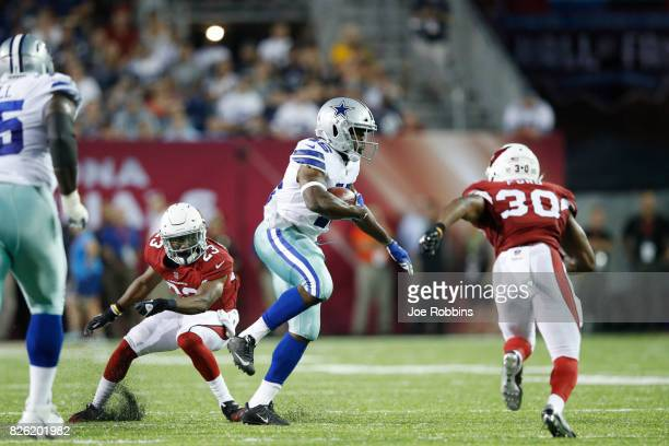 Alfred Morris of the Dallas Cowboys runs for a 25yard gain in the second quarter of the NFL Hall of Fame preseason game against the Arizona Cardinals...