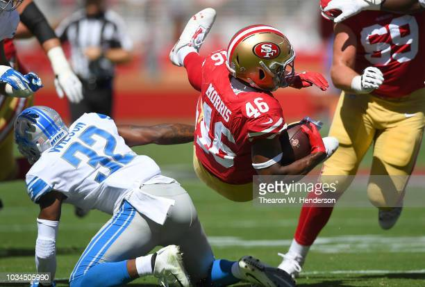 Alfred Morris of the San Francisco 49ers gets tackled by Tavon Wilson of the Detroit Lions during the second quarter of their NFL football game at...