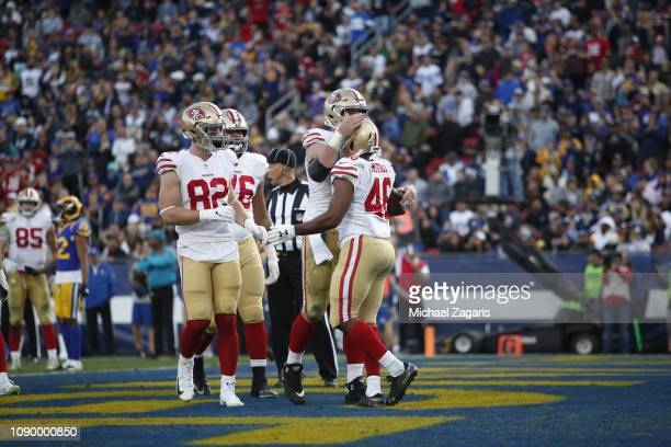 Alfred Morris of the San Francisco 49ers is congratulated after a touchdown during the game against the Los Angeles Rams at the LA Memorial Coliseum...