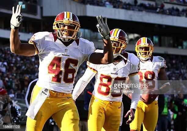 Alfred Morris of the Washington Redskins celebrates a touchdown with teammates Santana Moss and Pierre Garcon at Lincoln Financial Field on December...
