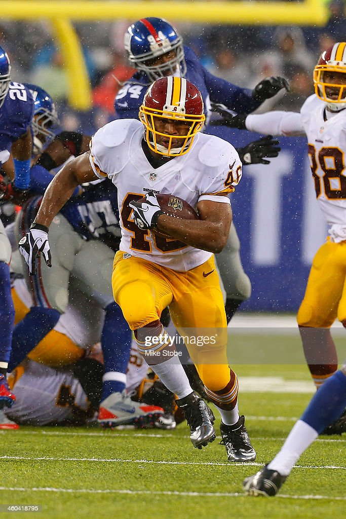Alfred Morris #46 of the Washington Redskins in action against the New York Giants at MetLife Stadium on December 29, 2013 in East Rutherford, New Jersey. Giants defeated the Redskins 20-6.