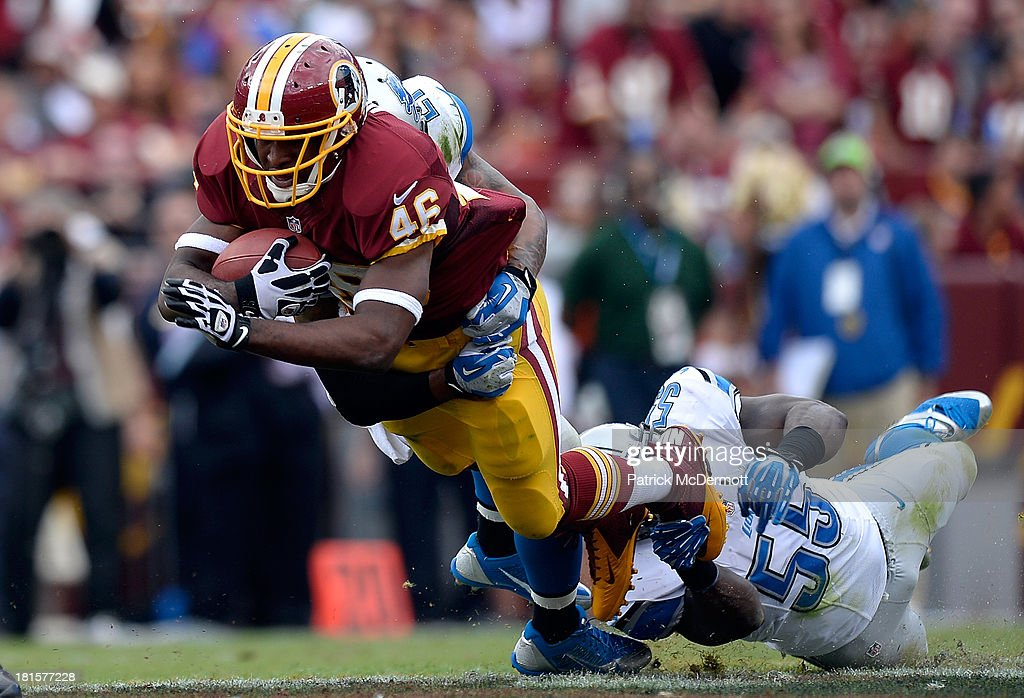 Alfred Morris #46 of the Washington Redskins is tackeld by Stephen Tulloch #55 of the Detroit Lions in the second quarter during a game at FedExField on September 22, 2013 in Landover, Maryland.