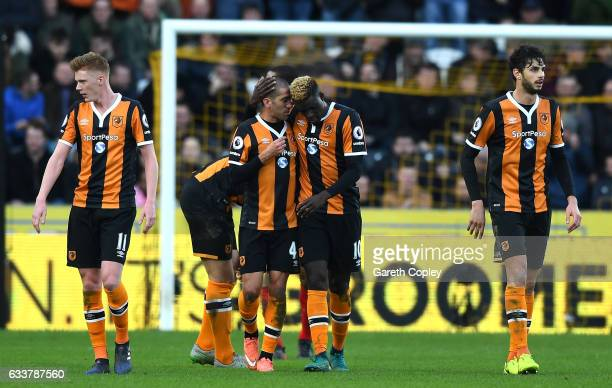 Alfred N'Diaye celebrates scoring his sides first goal with Evandro of Hull City during the Premier League match between Hull City and Liverpool at...