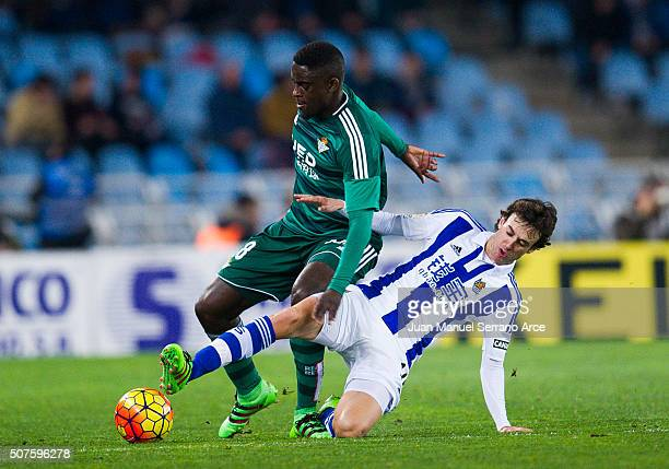Alfred N'Diaye of Real Betis Balompie duels for the ball with Ruben Pardo of Real Sociedad during the La Liga match between Real Sociedad de Futbol...