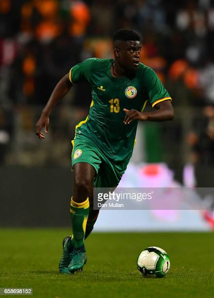 Alfred N'Diaye of Senegal looks for a pass during the International Friendly match between the Ivory Coast and Senegal at the Stade Charlety on March...