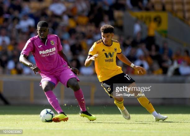 Alfred N'Diaye of Villarreal and Morgan GibbsWhite of Wolverhampton Wanderers during a preseason friendly between Wolverhampton Wanderers and...