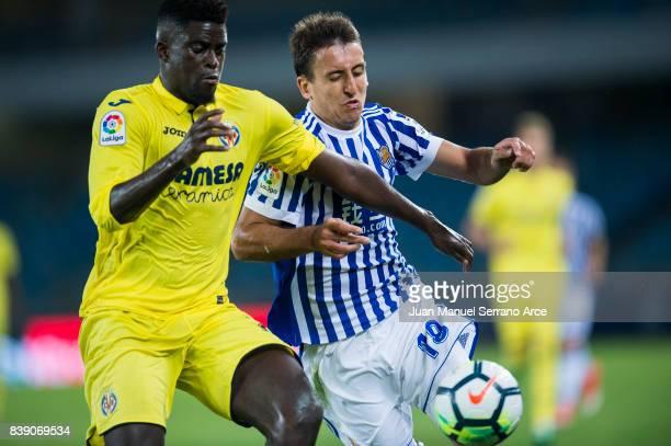 Alfred N'Diaye of Villarreal CF duels for the ball with Mikel Oyarzabal of Real Sociedad during the La Liga match between Real Sociedad de Futbol and...