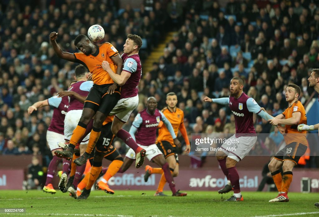 Alfred N'Diaye of Wolverhampton Wanderers wins this corner during the Sky Bet Championship match between Aston Villa and Wolverhampton Wanderers at Villa Park on March 10, 2018 in Birmingham, England.