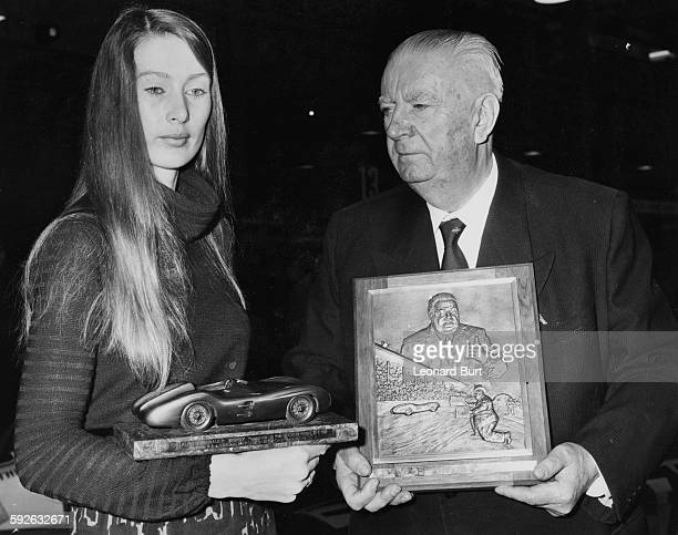 Alfred Neubauer former racing manager of Mercedes Benz presenting Nina Rindt the widow of racing driver Jochen Rindt with a plaque and trophy...