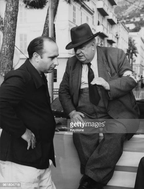 Alfred Neubauer , racing manager of the Mercedes-Benz Grand Prix team, talking with Argentine driver Juan Manuel Fangio during official trials for...