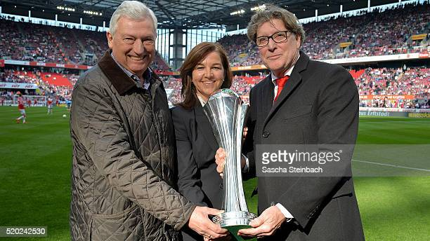Alfred Vianden president of the football federation middle rhine Heike Ullrich of DFB and Toni Schumacher of 1 FC Koeln pose with the women's...