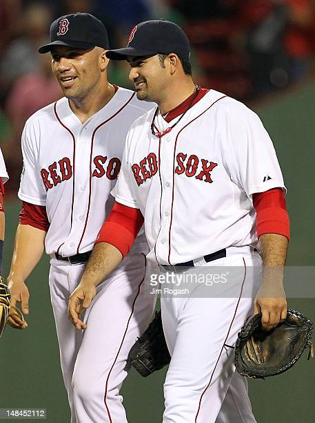 Alfredo Aceves of the Boston Red Sox and Adrian Gonzalez celebrate a 51 win over the Chicago White Sox at Fenway Park July 16 2012 in Boston...