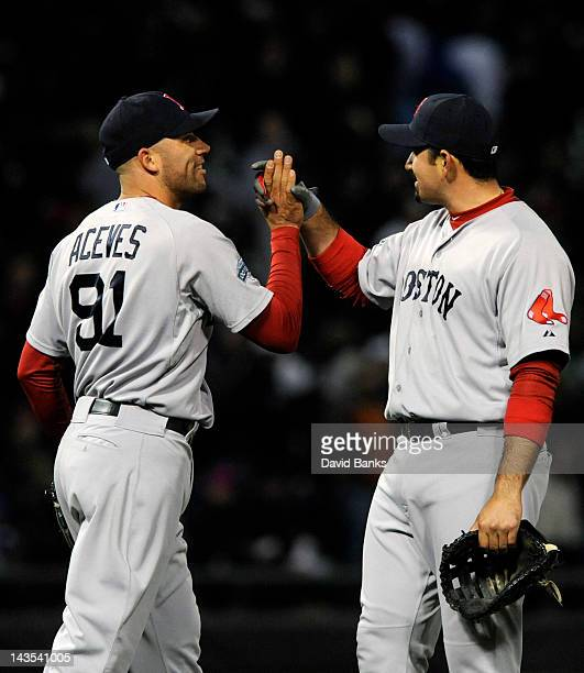 Alfredo Aceves of the Boston Red Sox and Adrian Gonzalez celebrate their victory against the Chicago White Sox on April 28 2012 at US Cellular Field...