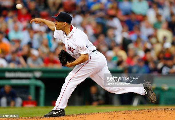Alfredo Aceves of the Boston Red Sox pitches against the Tampa Bay Rays during the game on June 18 2013 at Fenway Park in Boston Massachusetts