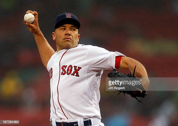 Alfredo Aceves of the Boston Red Sox throws during a game with Oakland Athletics at Fenway Park on April 23 2013 in Boston Massachusetts