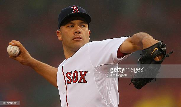 Alfredo Aceves of the Boston Red Sox throws during a game with the Oakland Athletics at Fenway Park on April 23 2013 in Boston Massachusetts