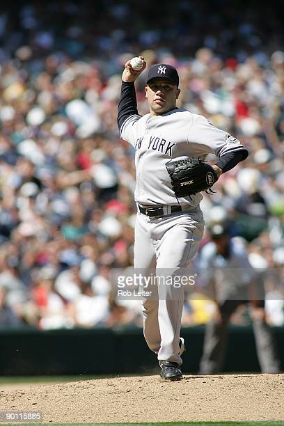Alfredo Aceves of the New York Yankees throws over to first base during the game against the Seattle Mariners at Safeco Field on August 16 2009 in...