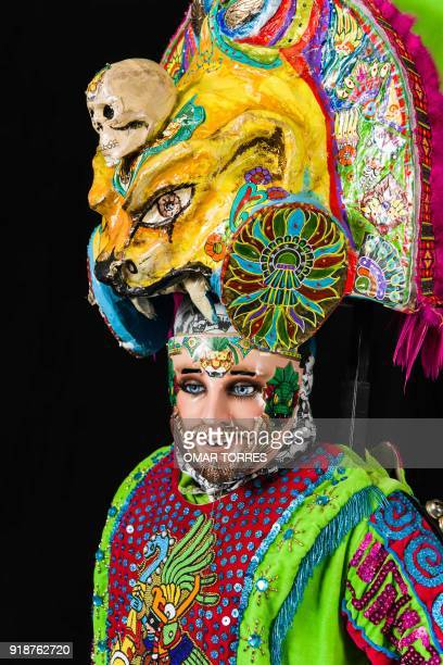 Alfredo Alvarez poses in his costume for the carnival in Tlaxcala Mexico on February 13 2018 The satirical costumes and masks were originally...