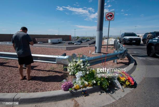 Alfredo Angcana prays beside a makeshift memorial outside the Cielo Vista Mall WalMart where a shooting left 20 people dead in El Paso Texas on...