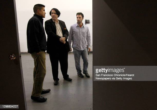Alfredo Aquino of Video Equipment Rentals advises artists David Mark and Ben Wood on the three projectors being used for the Coit tower projection in...