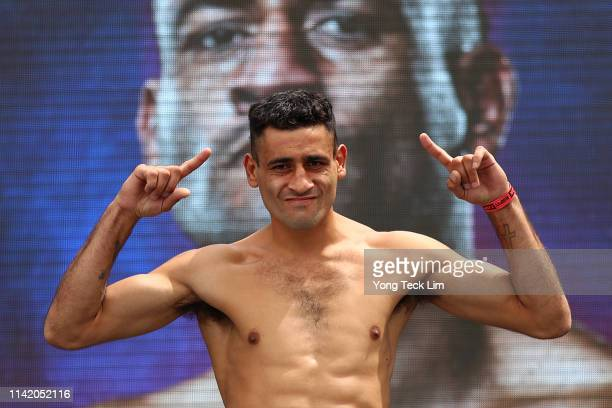 Alfredo Blanco poses on the scale during his official weighin ahead of his USBA welterweight title fight against Alexander Besputin at Los Angeles...