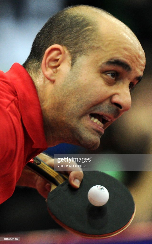 Alfredo Carneros of Spain services to Kazuhiro Chan of Japan during the men's teams group C match at the 2010 World Team Table Tennis Championships in Moscow on May 26, 2010.