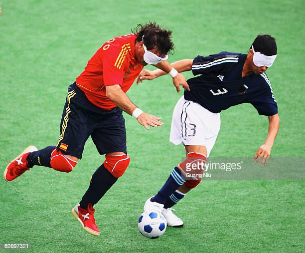 Alfredo Cuadrado of Spain fights a ball with Gustavo Maidana of Argentina in the Five-A-Side Football match during the Beijing Paralympics at Olympic...