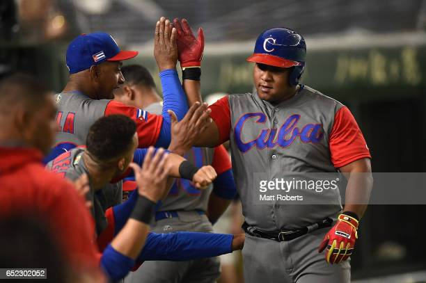 Alfredo Despaigne of Cuba celebrates after hitting a homer on a line drive to left center field in the second inning during the World Baseball...