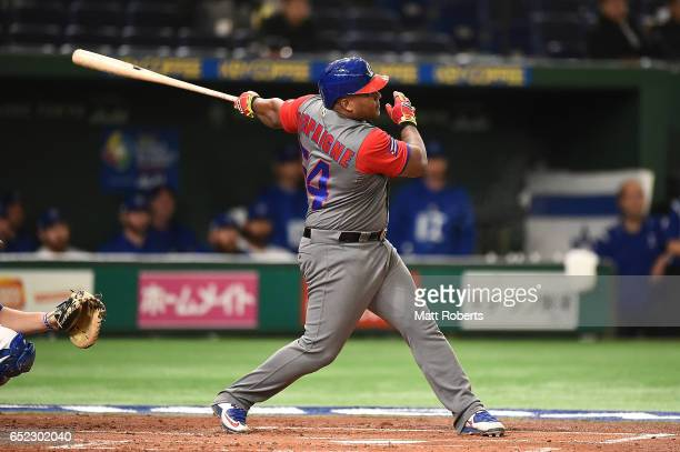 Alfredo Despaigne of Cuba hits a homer on a line drive to left center field in the second inning during the World Baseball Classic Pool E Game One...