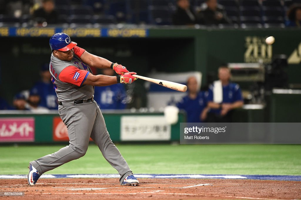 Alfredo Despaigne #54 of Cuba hits a homer on a line drive to left center field in the second inning during the World Baseball Classic Pool E Game One between Cuba and Israel at Tokyo Dome on March 12, 2017 in Tokyo, Japan.