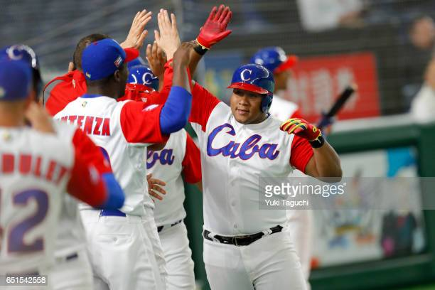 Alfredo Despaigne of Team Cuba is greeted in the dugout after hitting a gland slam in the fifth inning during Game 5 of Pool B of the 2017 World...