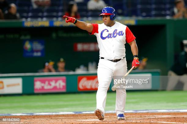 Alfredo Despaigne of Team Cuba points dugout after hitting a gland slam in the fifth inning during Game 5 of Pool B of the 2017 World Baseball...