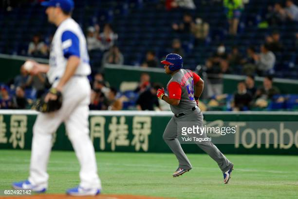 Alfredo Despaigne of Team Cuba rounds the bases after hitting a solo home run in the second inning during Game 1 of Pool E against Team Israel at the...