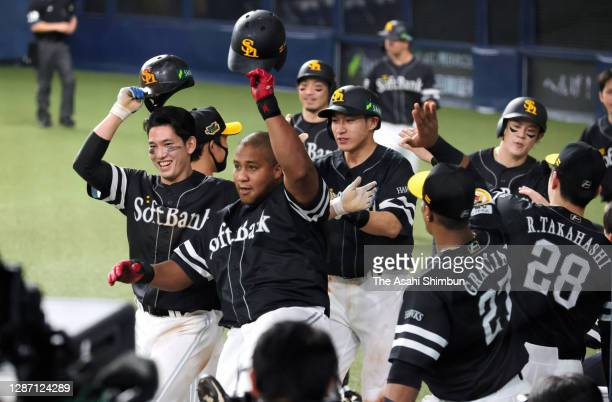 Alfredo Despaigne of the Fukuoka SoftBank Hawks celebrates with his team mates after hitting a grand slam to make it 11-2 in the 7th inning during...