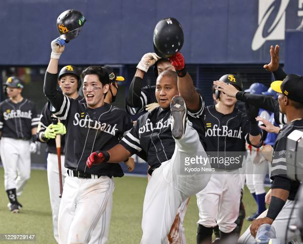 Alfredo Despaigne poses with SoftBank Hawks teammate Ryoya Kurihara after hitting a grand slam in the seventh inning in Game 2 of the Japan Series...