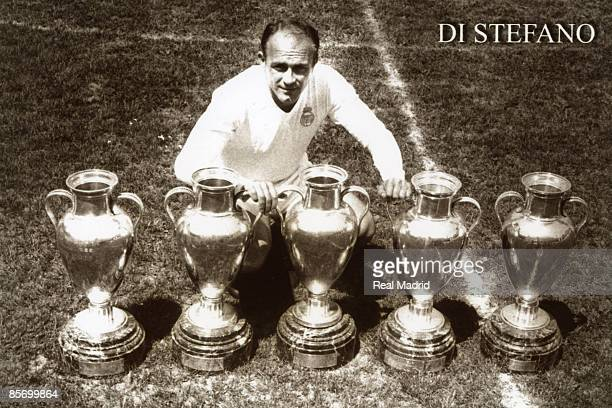 Alfredo Di Stefano of Real Madrid poses with European Cup trophies