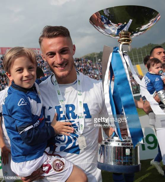Alfredo Donnarumma of Brescia Calcio celebrates with the trophy after winning the Serie B Championship at the end of the Serie B match between...