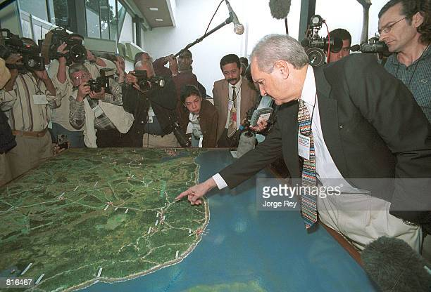 Alfredo Duran explains to journalists March 22 2001 the operation that he carried out during the invasion of Cube by US backed Cuban exiles at the...