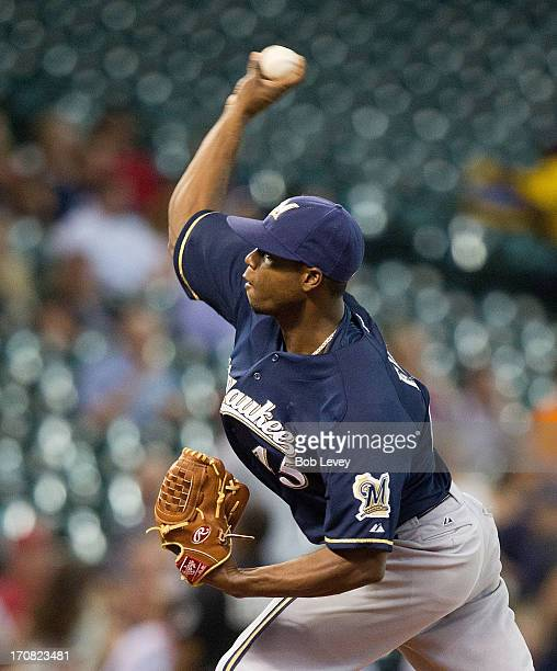 Alfredo Figaro of the Milwaukee Brewers pitches against the Houston Astros in the first inning at Minute Maid Park on June 18 2013 in Houston Texas