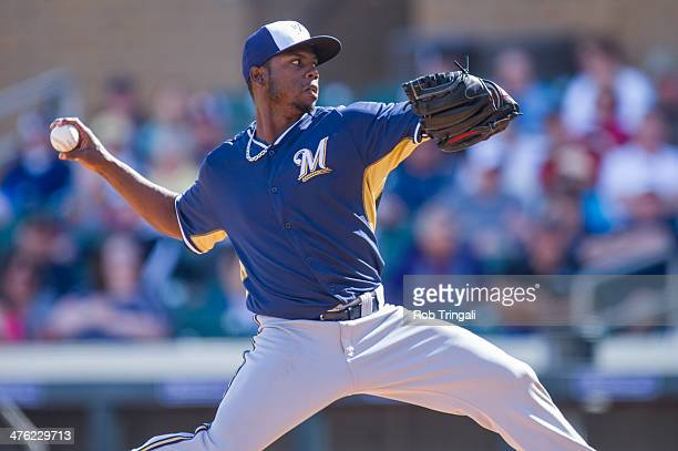 Alfredo Figaro of the Milwaukee Brewers pitches during a spring training game against the Colorado Rockies at Salt River Fields at Talking Stick on...