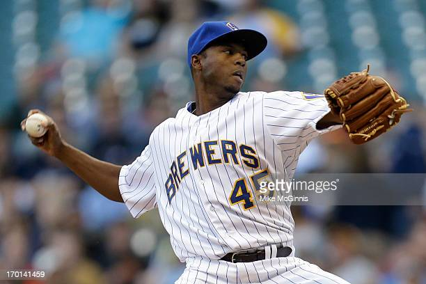 Alfredo Figaro of the Milwaukee Brewers pitches in the top of the first inning against the Philadelphia Phillies at Miller Park on June 07 2013 in...