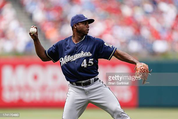 Alfredo Figaro of the Milwaukee Brewers throws the ball to first during the game against the Philadelphia Phillies at Citizens Bank Park on June 2...