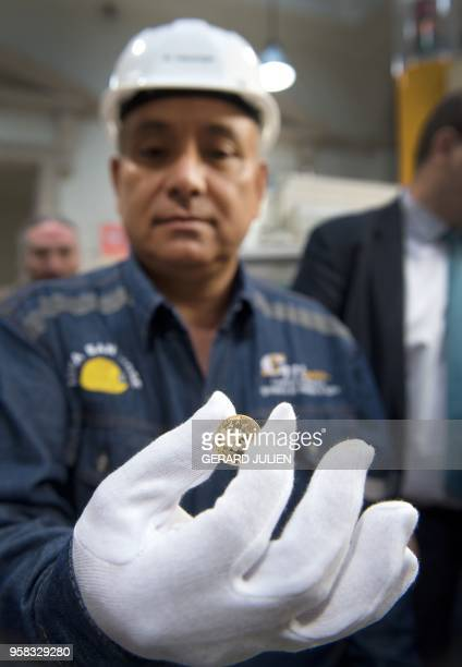 Alfredo Gonzales Colombian artisanal miner of the mining cooperative of Iquira in Colombia shows the first Fairmined coin emitted by the Monnaie de...